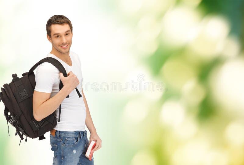 Estudante de viagem com trouxa e livro imagens de stock
