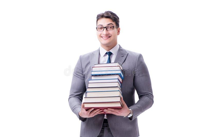 Estudante do homem de negócios que leva guardando a pilha dos livros isolados em w foto de stock