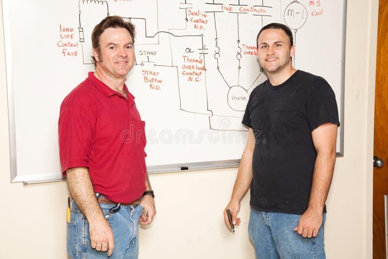 Estudante e professor da engenharia imagem de stock