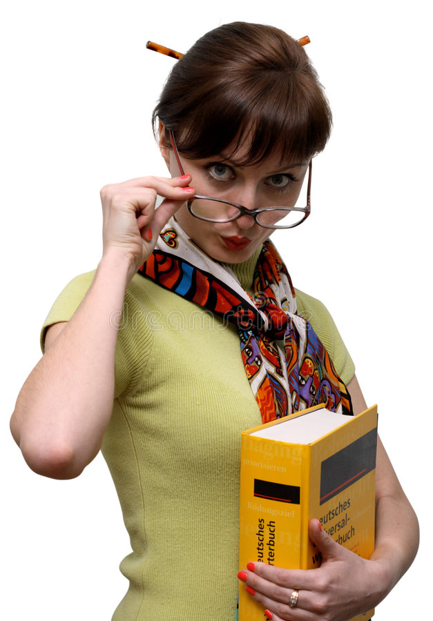 Estudante engraçado com um dicionário imagem de stock