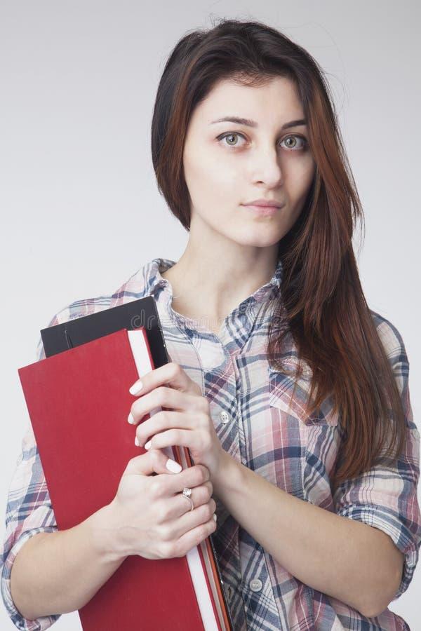 Estudante fêmea bonito com livros & x28; educação, ciência, develdo auto de foto de stock