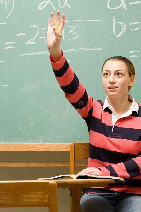 Estudante fêmea com sua mão levantada fotos de stock