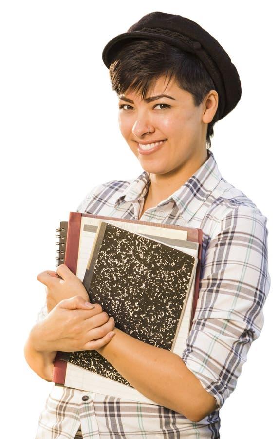 Estudante fêmea de sorriso Holding Books Isolated de raça misturada fotos de stock