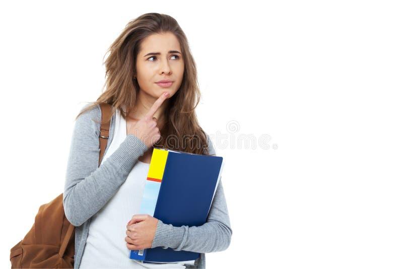 Estudante fêmea novo pensativo isolado no branco foto de stock