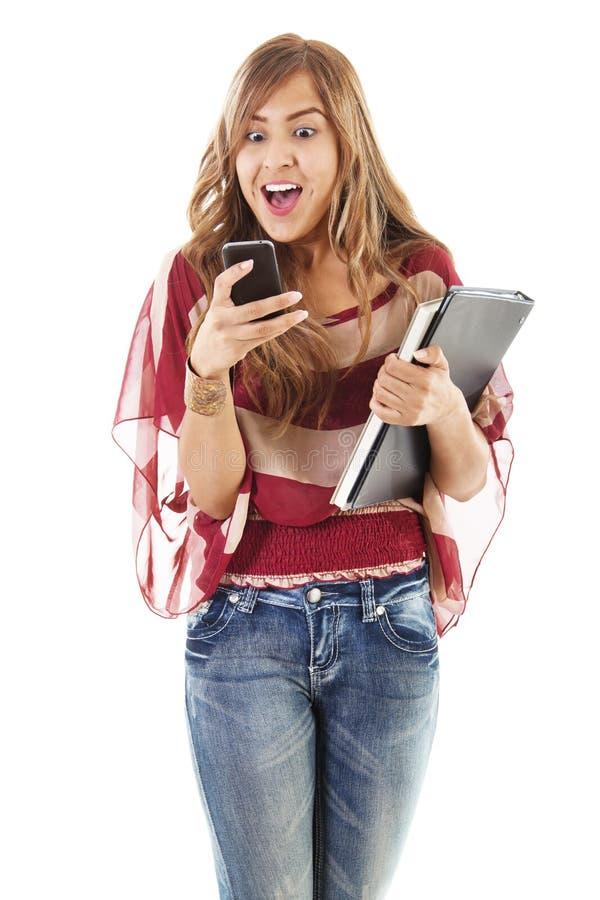 Estudante fêmea que texting imagem de stock