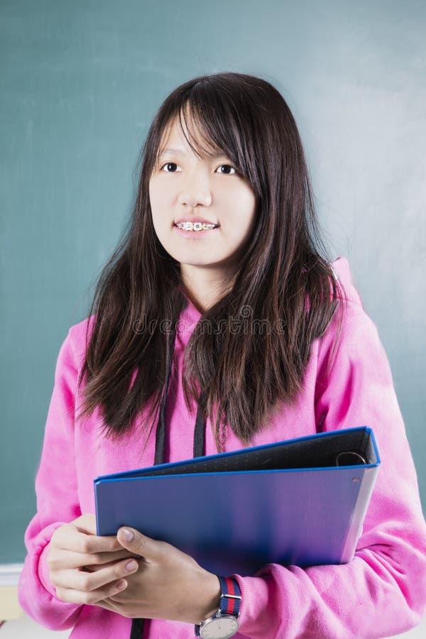 Estudante feliz com cintas imagem de stock