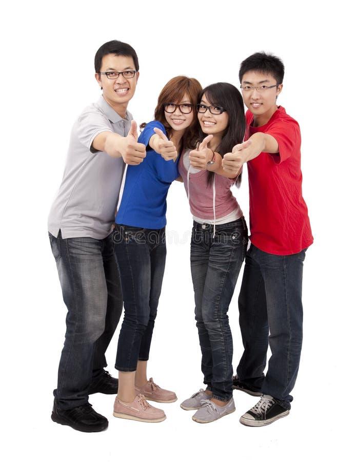 Estudante feliz com polegar acima imagem de stock royalty free