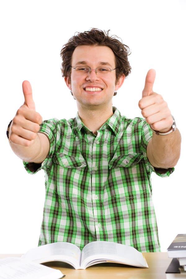 Estudante feliz louco, polegares acima, isolado no branco fotos de stock