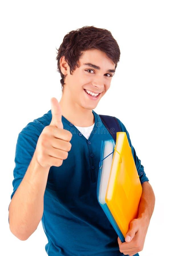 Estudante feliz novo que mostra os polegares acima fotos de stock