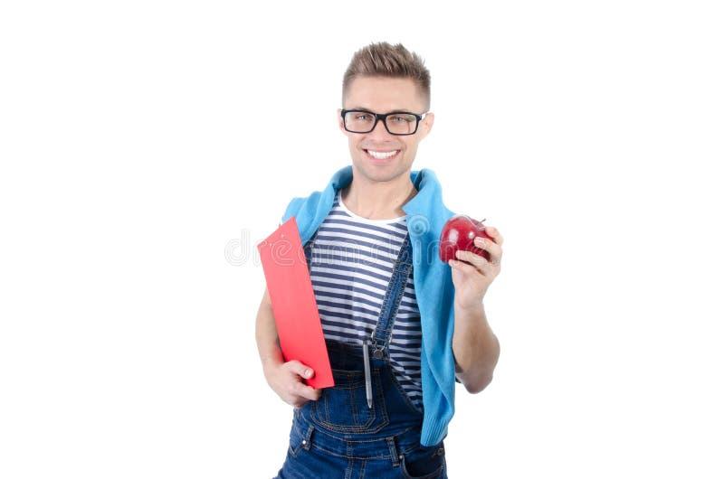 Estudante feliz que guarda uma prancheta e uma maçã fotografia de stock