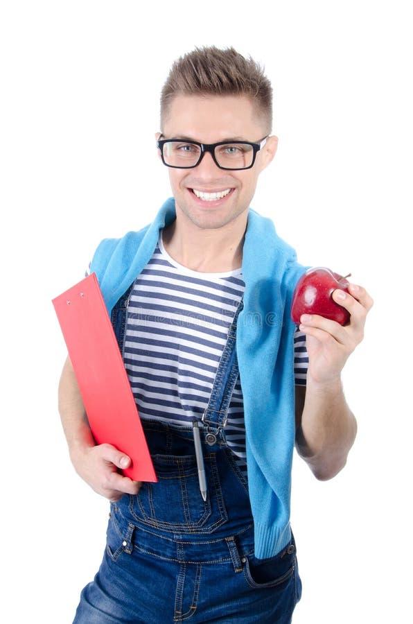 Estudante feliz que guarda uma prancheta e uma maçã imagem de stock