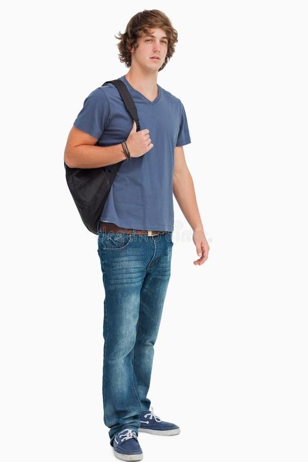 Estudante masculino com uma trouxa fotos de stock royalty free