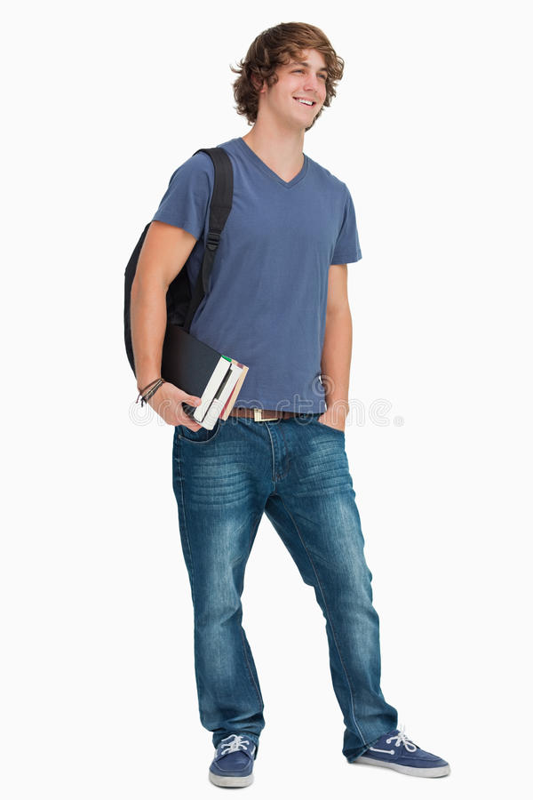 Estudante masculino com uma trouxa que guardara livros imagens de stock