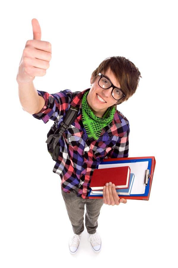 Estudante masculino que mostra os polegares acima foto de stock