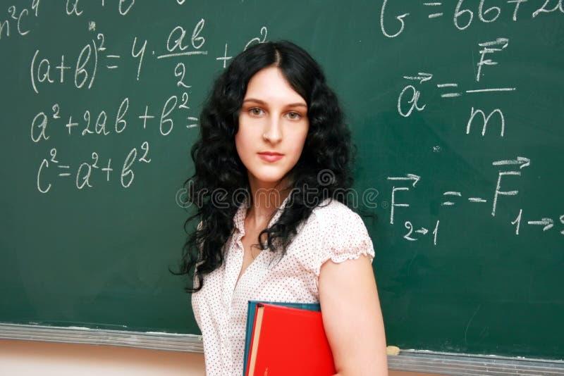Estudante no quadro-negro imagem de stock