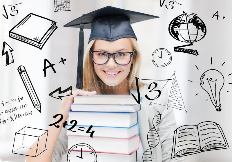 Estudante no tampão da graduação imagens de stock