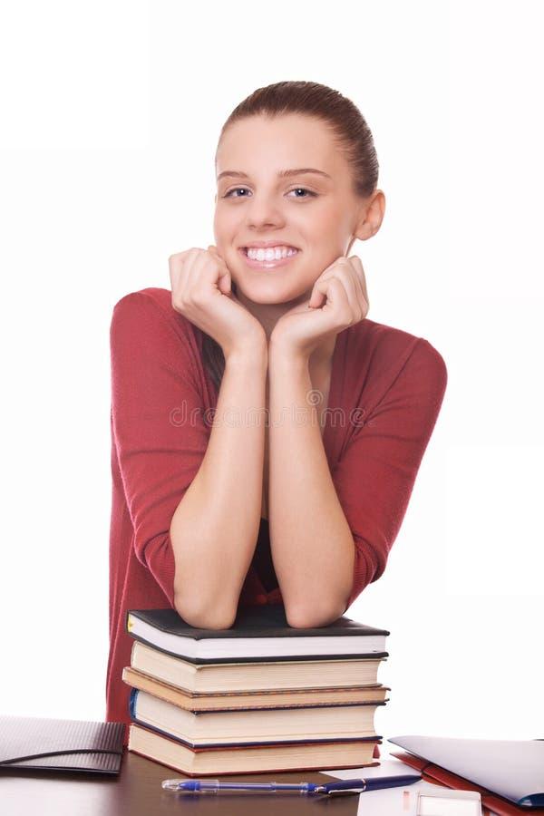 Estudante nova com livros imagem de stock