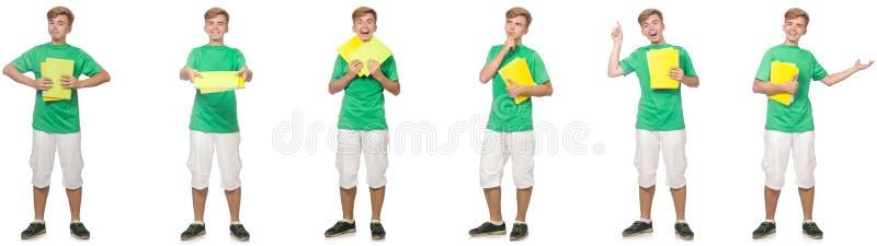 Estudante novo com as notas isoladas no branco fotografia de stock