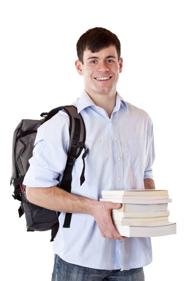 Estudante novo, considerável, feliz com livros imagens de stock