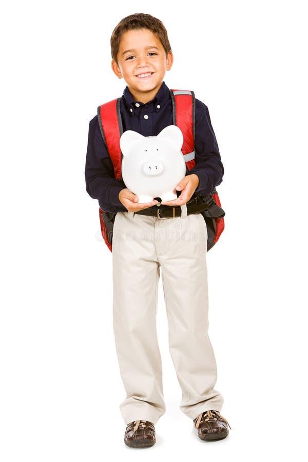Estudante: O menino guarda o mealheiro imagens de stock royalty free