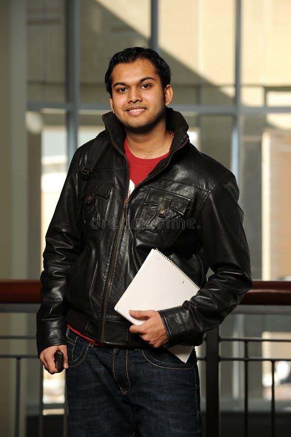 Estudante oriental novo que prende um copybook fotografia de stock