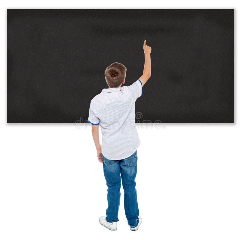 Estudante que aponta no quadro vazio imagens de stock royalty free
