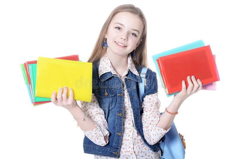 Estudante que levanta com os livros isolados no fundo branco fotografia de stock royalty free