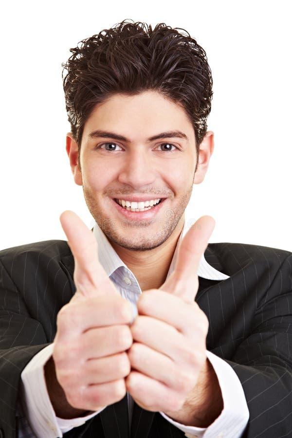 Estudante que mantem ambos os polegares fotos de stock royalty free