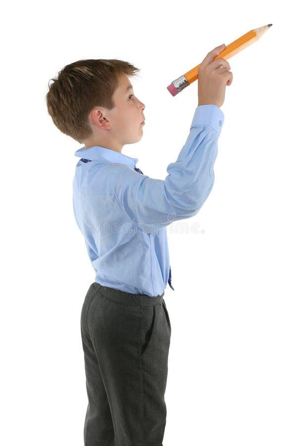 Estudante que prende um lápis aproximadamente para escrever imagem de stock royalty free