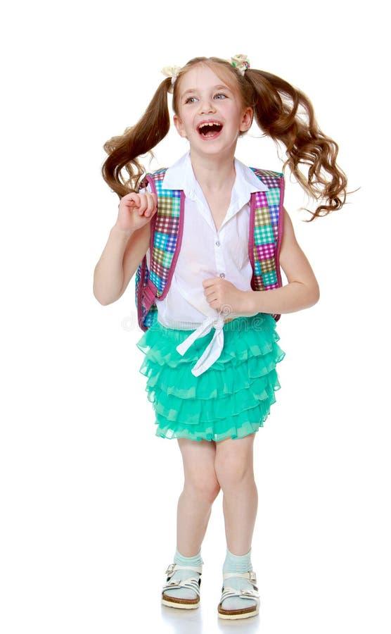 A estudante que salta com uma pasta foto de stock royalty free