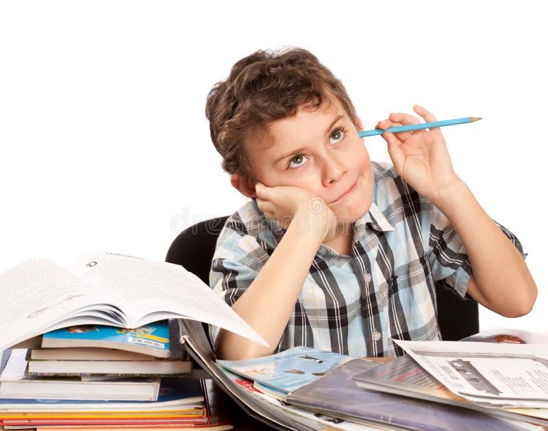 Estudante relutante a fazer trabalhos de casa imagem de stock royalty free