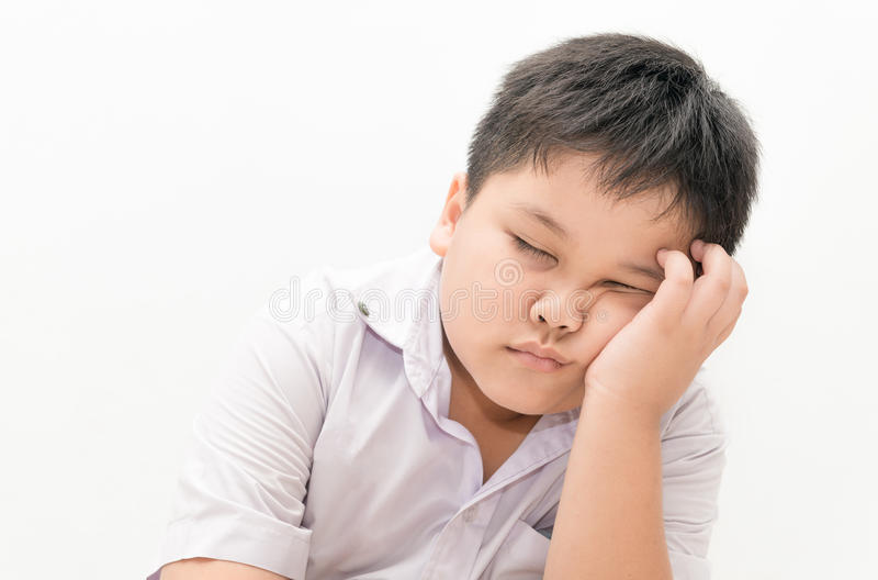 Estudante tailandês do menino sonolento fotografia de stock royalty free