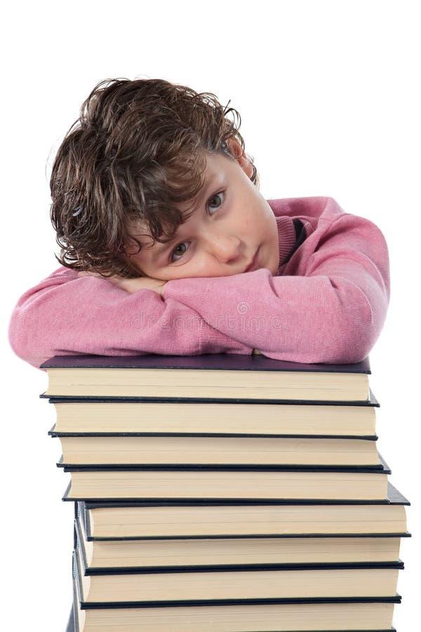 Estudante Tired da criança fotografia de stock royalty free