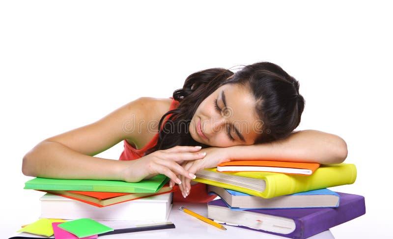 Estudante Tired que dorme em livros fotografia de stock