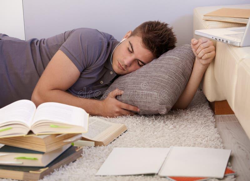 Estudante universitário adormecido imagem de stock