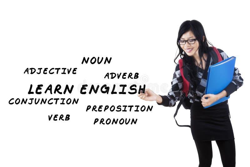 A estudante universitário escreve a lição inglesa fotografia de stock