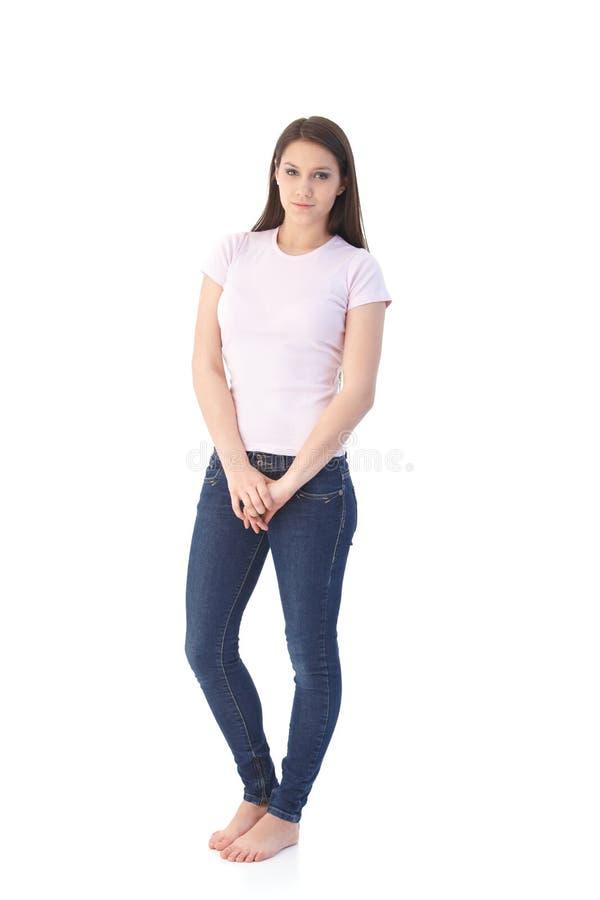 Estudante universitário no t-shirt e nas calças de brim fotografia de stock royalty free