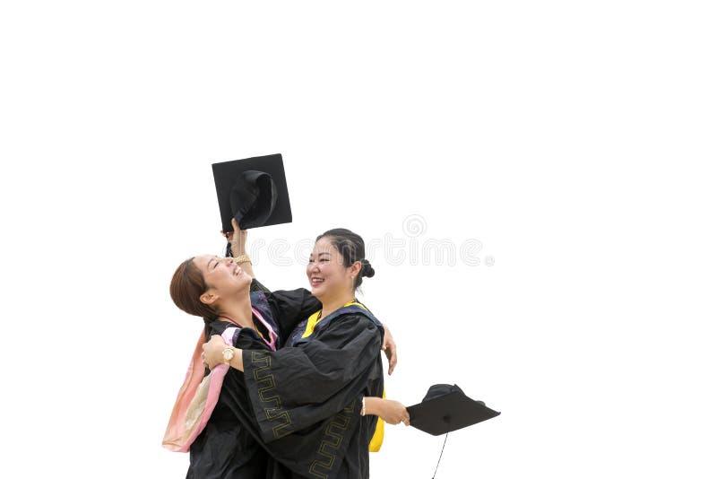 Estudantes doutorais vestindo de uma roupa da graduação fotografia de stock royalty free