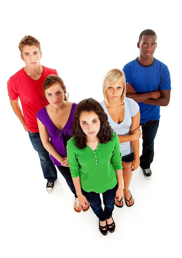Estudantes: Grupo Multi-étnico sério de adolescentes fotografia de stock royalty free