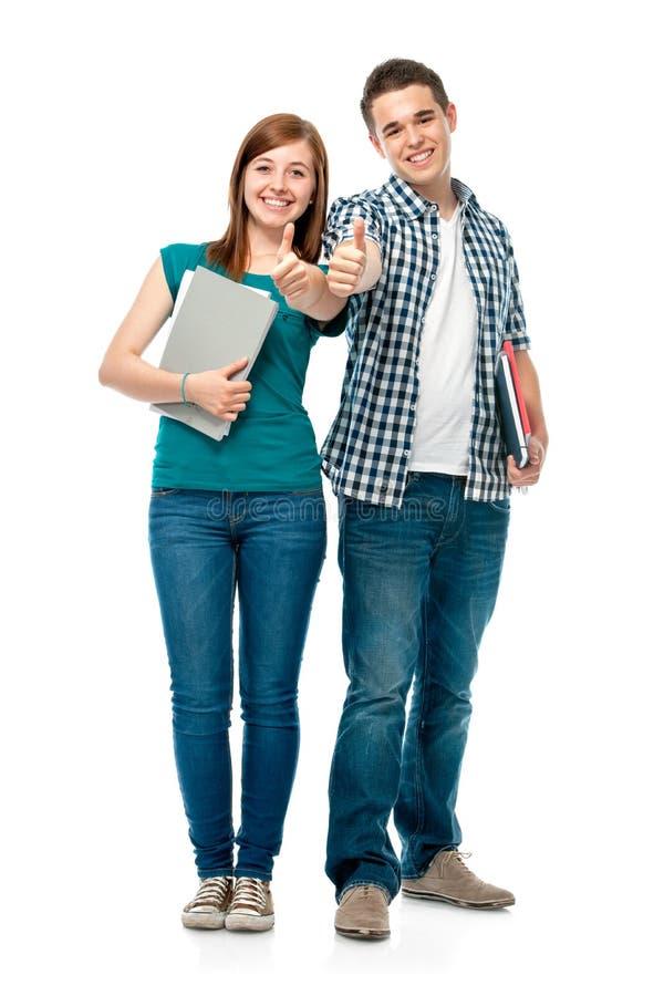 Estudantes que mostram os polegares-acima imagens de stock royalty free