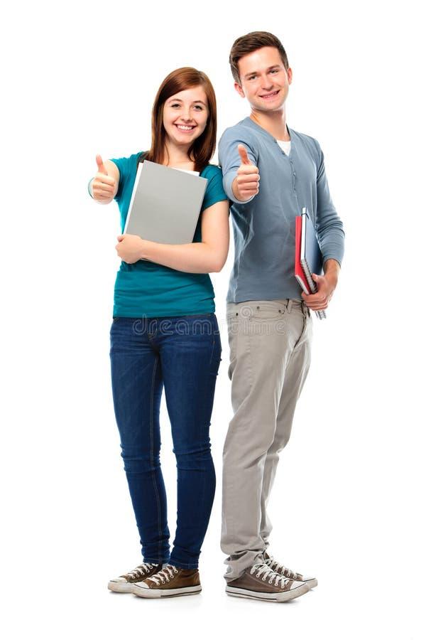 Estudantes que mostram os polegares-acima fotos de stock