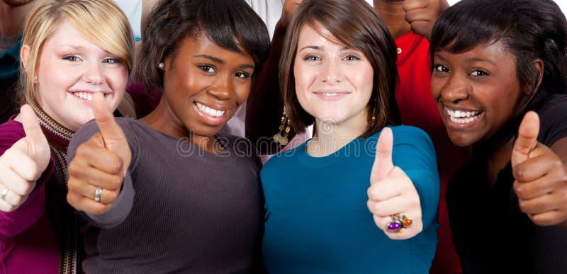 Estudantes universitários Multi-racial com polegares acima imagem de stock royalty free