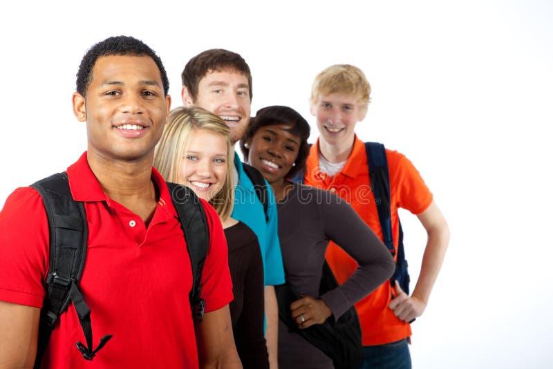 Estudantes universitários Multi-racial no branco foto de stock royalty free