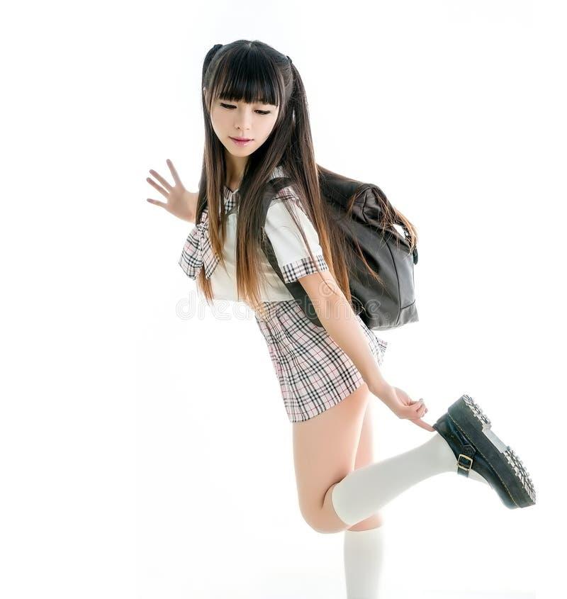 Estudiante asiática atractiva en uniforme escolar imágenes de archivo libres de regalías