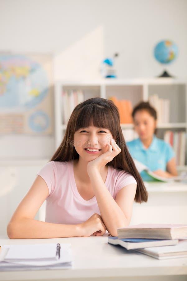 Estudiante asiático Enjoying Lesson imagen de archivo libre de regalías