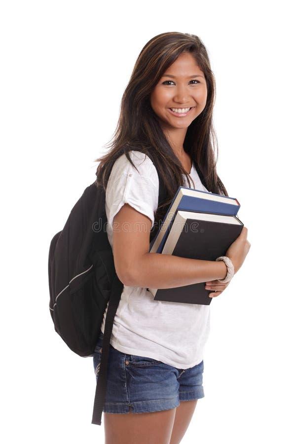 Estudiante asiático femenino con los libros y el morral fotos de archivo libres de regalías