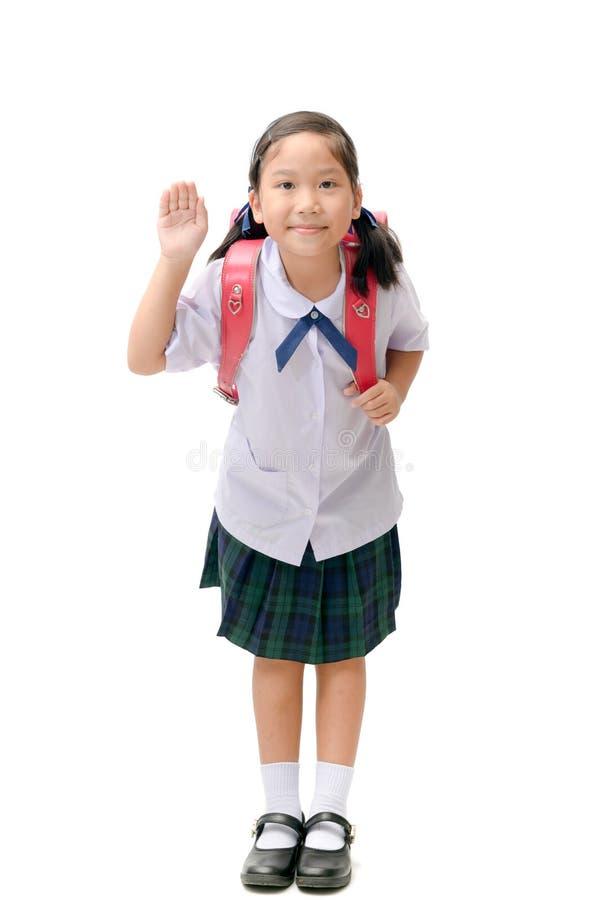 Estudiante asiático lindo con el bolso de escuela aislado fotos de archivo