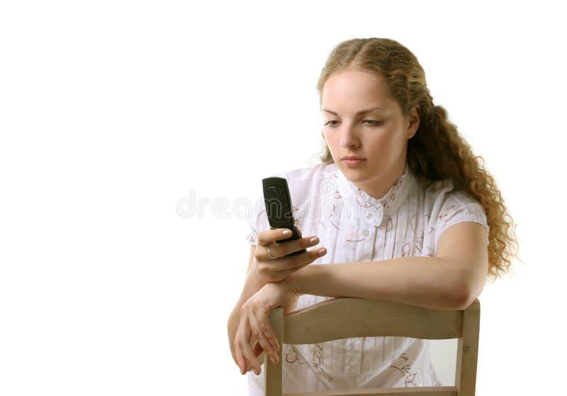 Estudiante bonito con el teléfono celular imágenes de archivo libres de regalías