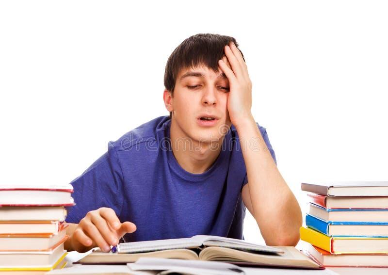 Estudiante cansado con los libros imagen de archivo libre de regalías