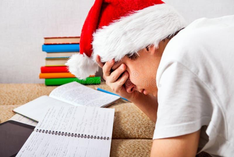 Estudiante cansado Doing Homework fotografía de archivo